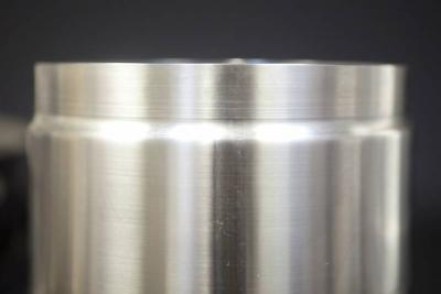 Reduced stainless steel rolled and welded cylinder